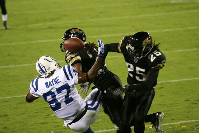 Reggie Nelson of the Jacksonville Jaguars hitting Reggie Wayne of the Indianapolis Colts - 2007