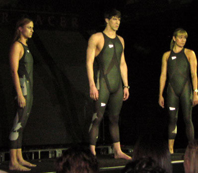 The LZR Racer Suit is unveiled at a press conference in New York City. Michael Phelps is at center, with Natale Coughlin to his left.